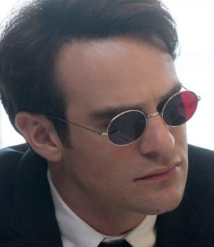 Charlie Cox as Matt Murdock / Daredevil wears a pair of custom round sunglasses with red lenses in Daredevil.