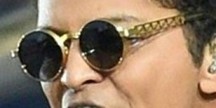 Bruno Mars wearing vintage gold Jean-Paul Gaultier sunglasses during Super Bowl 50