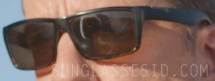 Enhanced image of the sunglasses worn by Ed Helms in Corporate Animals