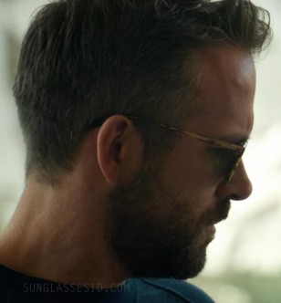 The sunglasses are worn by Ryan Reynolds at the end of the film 6 Underground