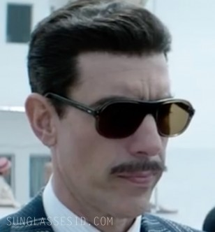 Sacha Baron Cohen wears 1970s style large aviator sunglasses in the Netflix series The Spy.