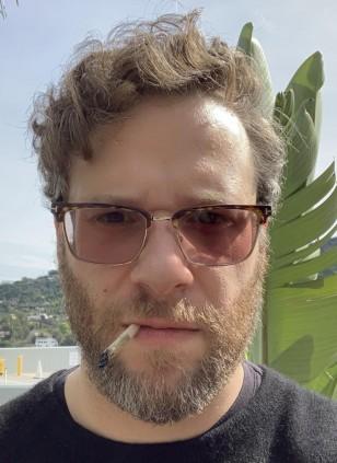 Seth Rogen wearing Tom Ford Half-Rim Optical FT5504 eyeglasses with transitional lenses.