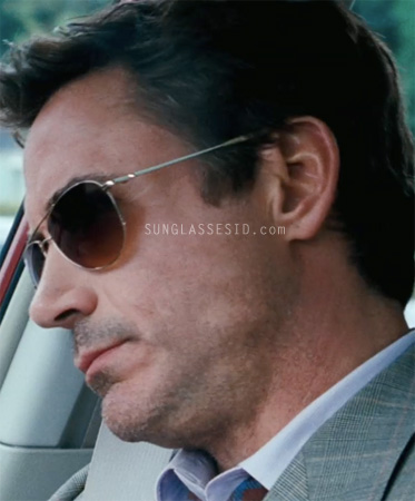 8d365e1079a Robert Downey Jr. wears Oliver Peoples Benedict sunglasses with gold frame  and chrome amber lenses