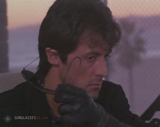 Sylvester Stallone taking off his Ray-Ban 3030 Outdoorsman sunglasses (you can c