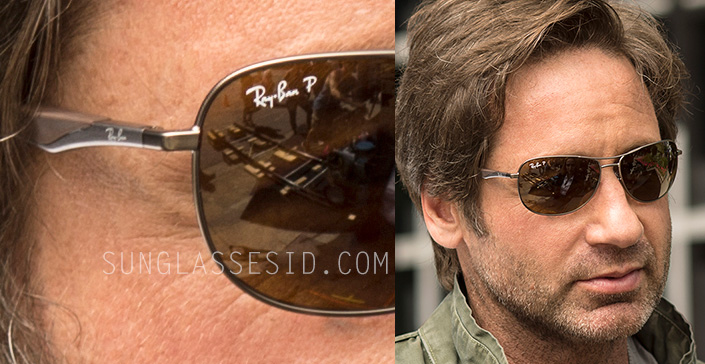 David Duchovny as Fox Mulder wears a pair of Ray-Ban RB3519 sunglasses in The X-Files.