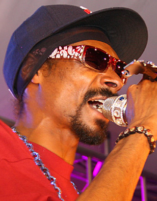 Snoop Dogg wearing red Serious Pimp OG Bandana sunglasses at the Playboy Mansion