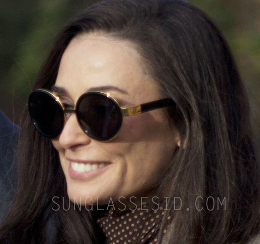 Demi Moore wears a pair of unidentified black and gold sunglasses in the movie Blind.