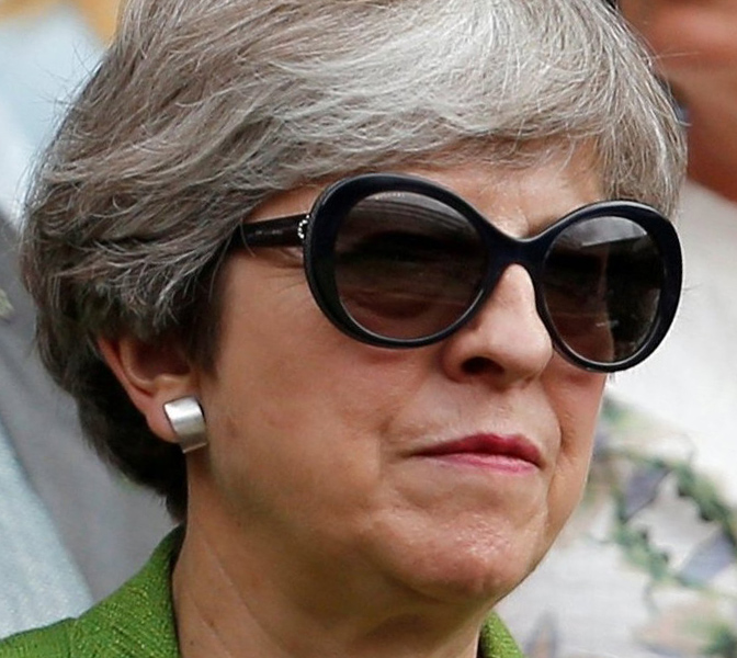 British Prime Minister Theresa May wears Bvlgari sunglasses during the Wimbledon Men's finals on July 16th 2017.
